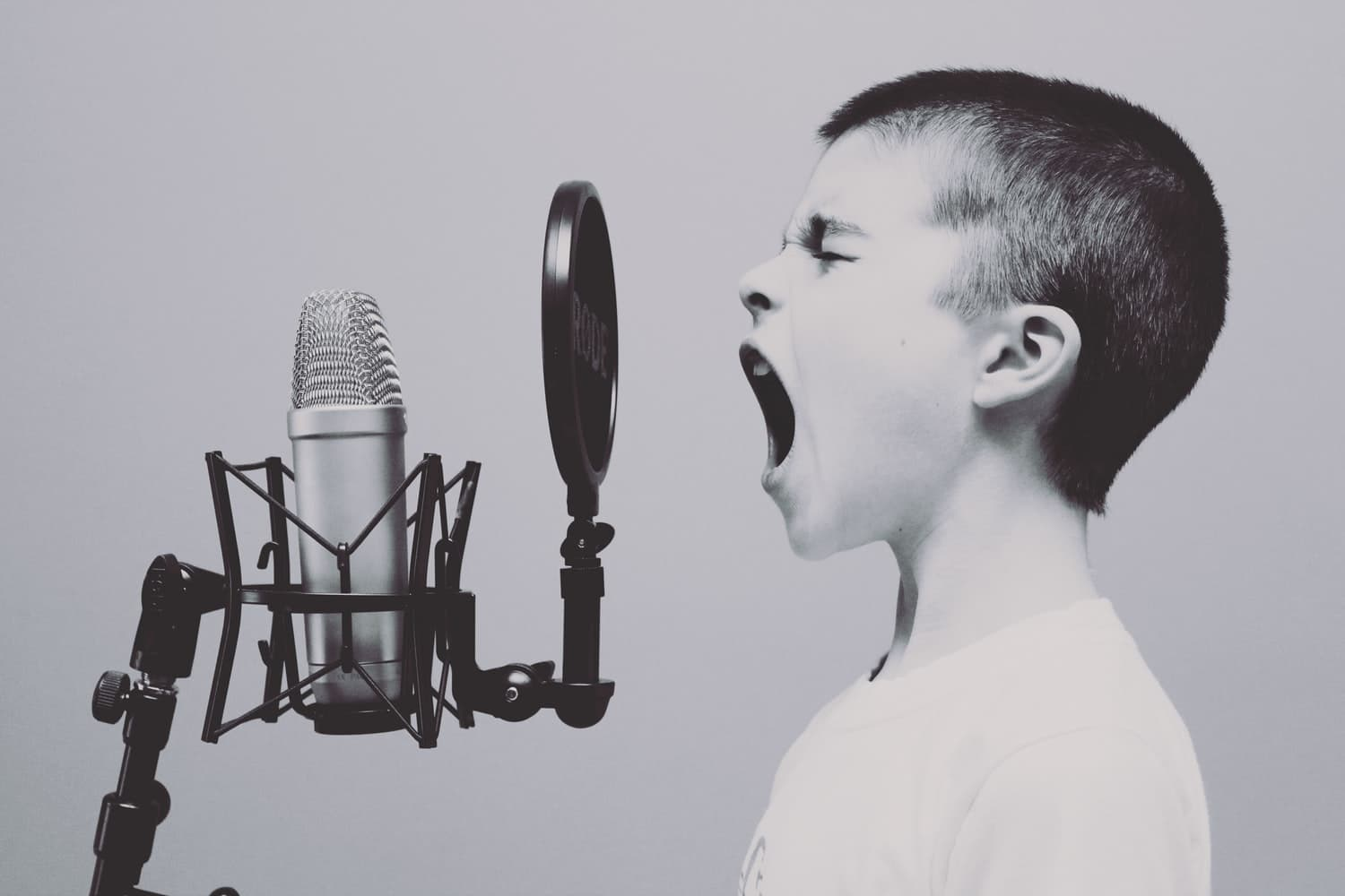 Boy shouting on a microphone